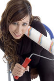 Posing smiling model with roller — Stock Photo