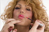 Beautician doing lip make up of woman — Stock Photo