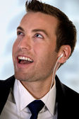 Portrait of businessman listening music — Stock Photo
