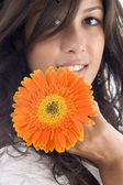 Close up of beautiful model with flower — Stock Photo