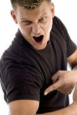 Man pointing his muscles and shouting — Stock Photo