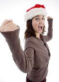 Successful teenager wearing santa hat — Stock Photo