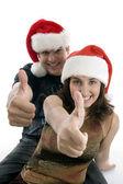 Young couple wishing good luck sign — Stock Photo