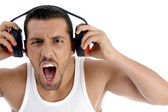 Caucasian guy enjoying rock music — Stock Photo