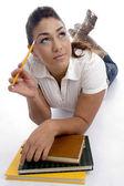 Beautiful knowledgeable girl thinking — Stock Photo