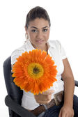 Lovely girl showing orange flower — Stock Photo