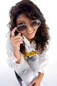 Woman winking from behind the eyeglasses — Stock Photo