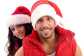Young friends dressed in christmas hat — Stockfoto