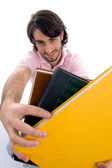 Young student showing books to camera — Stockfoto