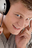 Young man with headphones enjoying music — Stock Photo