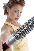 Woman posing with roller comb — Stock Photo