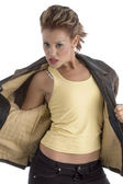 Sexy pose of woman taking off her coat — Stock Photo