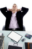 Young businessman relaxing in office — Stock Photo
