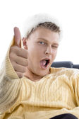 Man showing thumbs up with winking eye — Stock Photo