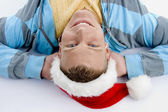 Relaxed man wearing christmas hat — Stock Photo