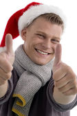 Cheerful young guy with thumbs up — Stock Photo