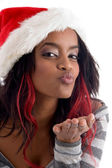 Female in saint hat blowing kiss — Stock Photo