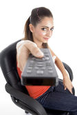 Young girl posing with remote — Stock Photo