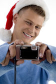 Young christmas boy capturing moments — Stok fotoğraf