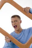 Young man posing with frame, enjoying — Stock Photo