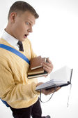 Smart young student managing his books — Stock Photo
