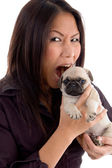 Angry young female holding puppy — Stock Photo