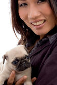 Pleased woman with cute puppy — Stock Photo