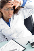 Female doctor in tension at workplace — Stock Photo