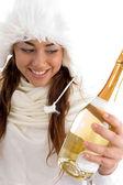 Smiling female holding champagne bottle — Stock Photo