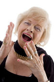 Portrait of happy old female laughing — Stock Photo