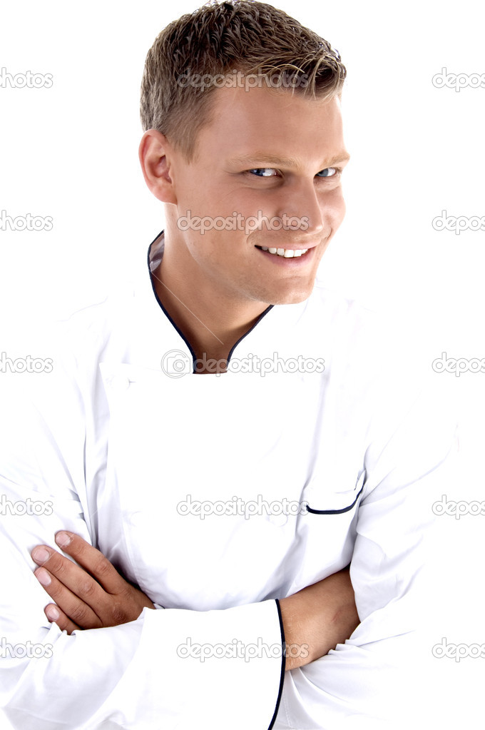 Young chef posing with his arms crossed on an isolated white background  Stock Photo #1652211