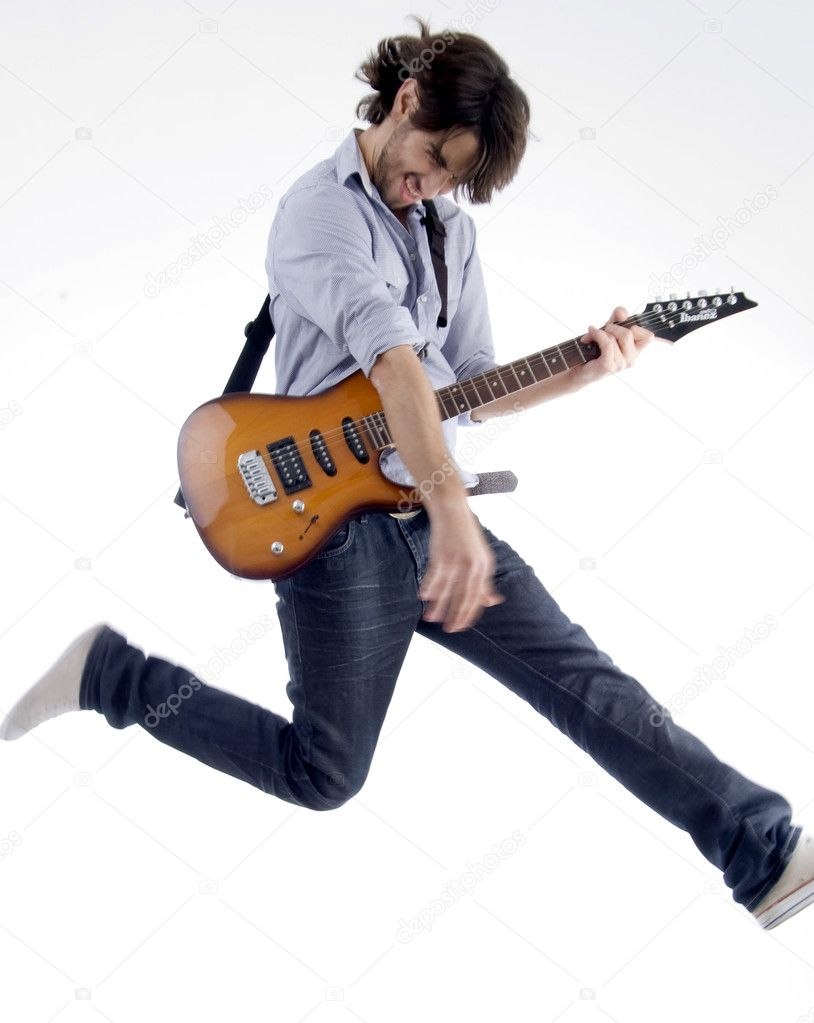 Man jumps while playing guitar on an isolated white background — Stock Photo #1652355