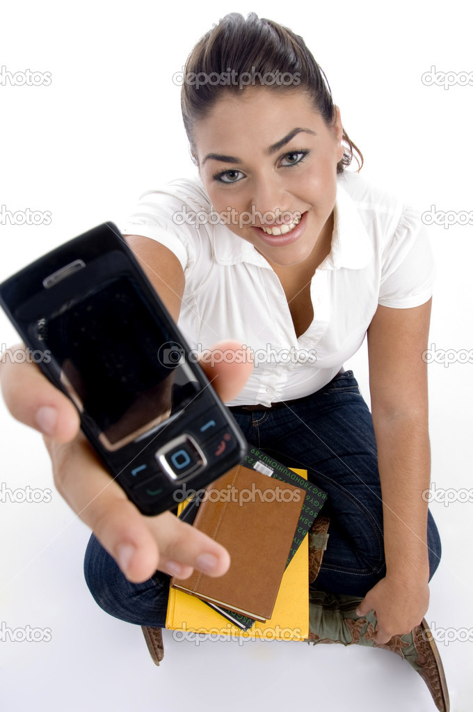 Teenager college showing her multimedia cell with white background — Stock Photo #1652827