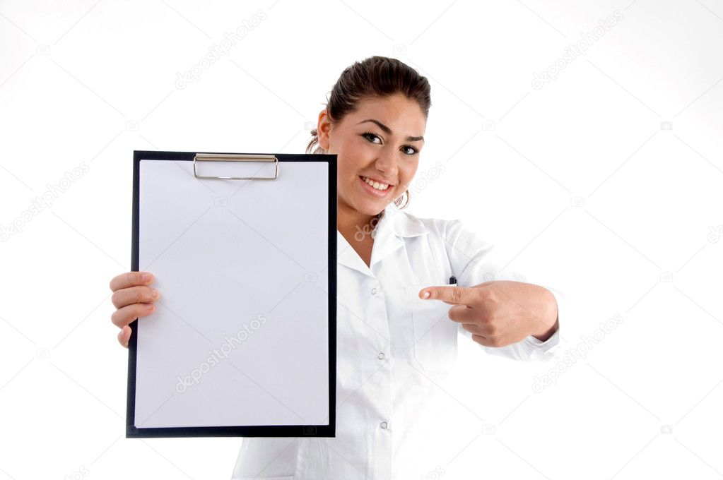 Smiling doctor indicating the writing board against white background — Lizenzfreies Foto #1652891