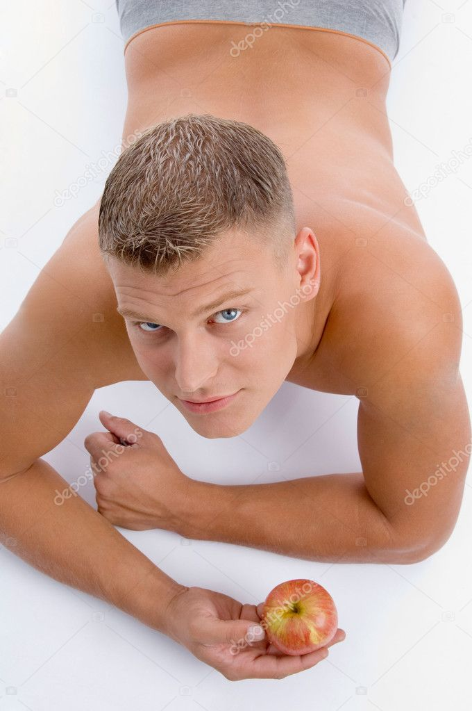 High angle view of muscular man with apple on an isolated white background — Stock Photo #1654325