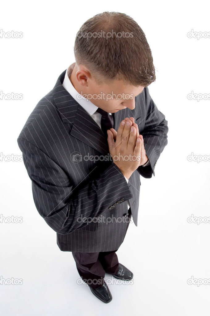 High angle view of praying businessman on an isolated white background — Stock Photo #1657499