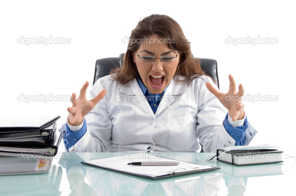 Frustrated doctor in workplace on an isolated white background — Stock Photo #1658864