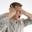 Man shouting loudly in anger — Stock Photo