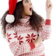 Stock Photo: Young womin christmas hat indicating