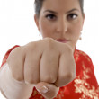 Female showing punch at camera — Stock Photo #1662276
