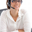 Woman with headset and folded hands - Stock Photo