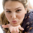 Gorgeous young beauty blowing kiss — Stock Photo