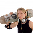 Stock Photo: Handsome mholding skateboard