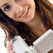 Young female holding handy cam - Stockfoto