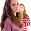 Beautiful pleased teen girls posing — Stock Photo