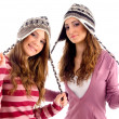 Girls stretching their woolen cap laces - Stockfoto