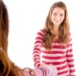 Friendly girls shaking hands and smiling — Stock Photo #1664588