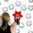 Back pose of man pointing at 3d red star — Stock Photo