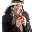Woman with winter cap holding coffee mug — Photo #1666172