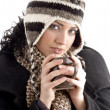 Woman with winter cap holding coffee mug — 图库照片